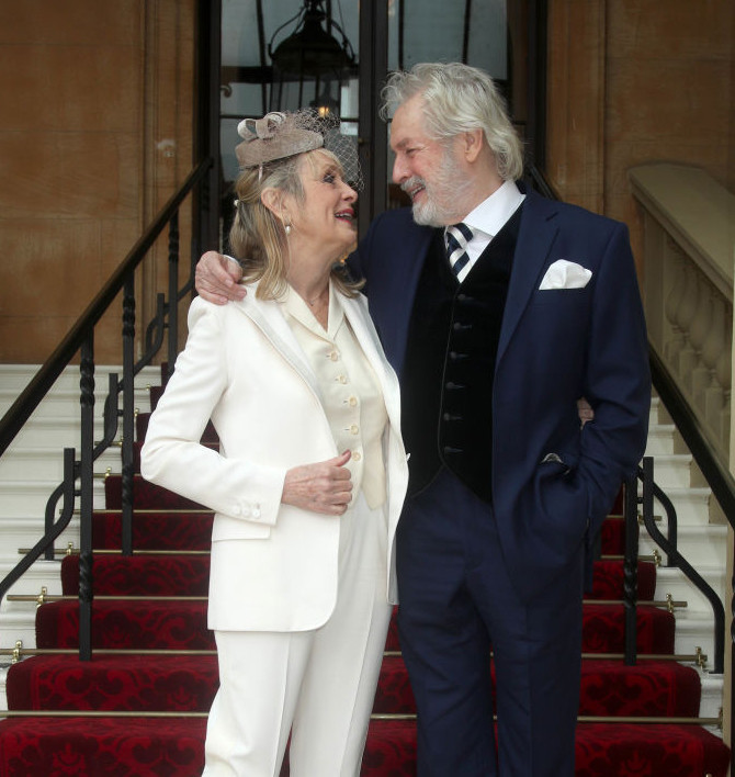 Lesley 'Twiggy' Lawson arrivesat Buckingham Palace with her husband Leigh.
